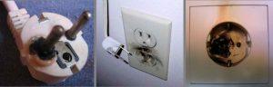 foto de tomada derretendo devido curto-circuito elétrica